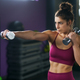 Sporty woman punching and boxing with dumbbells - PhotoDune Item for Sale