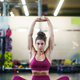 Young woman Doing Stretching Exercises on a yoga mat - PhotoDune Item for Sale