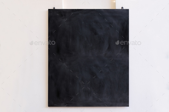 Blackboard hanging on white wall background. Black blank board, school education sign, mockup, - Stock Photo - Images