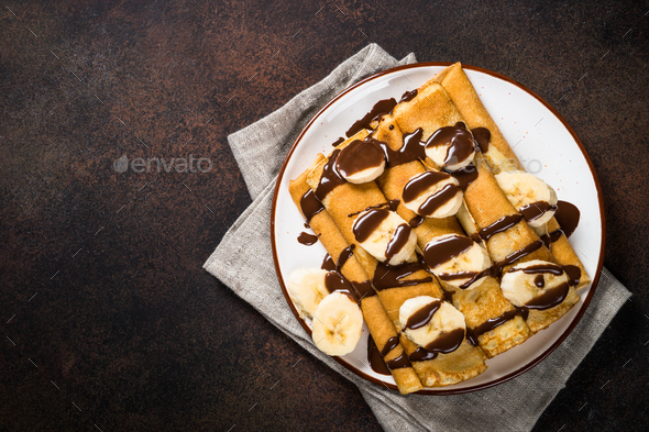 Crepes with chocolate and banana top view - Stock Photo - Images
