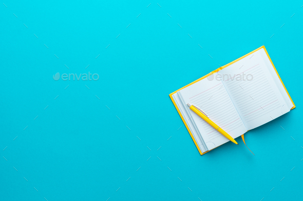 Top View Of Opened Notebook And Pen On Turquoise Blue Background With Copy Space - Stock Photo - Images