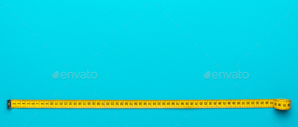 Top View Of Yellow Measuring Tape Over Turquoise Blue Background With Copy Space - Stock Photo - Images