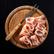 Smoked bacon strips and fork on cutting board. - PhotoDune Item for Sale