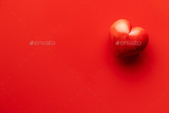 Red heart on red background. - Stock Photo - Images