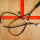 Squash rackets and ball on court floor, top view - PhotoDune Item for Sale