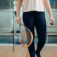 Female person shows squash racket and ball - PhotoDune Item for Sale