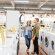 Couple choosing washing machine, electronics store - PhotoDune Item for Sale