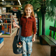 Little girl with her puppy in bag, pet store - PhotoDune Item for Sale