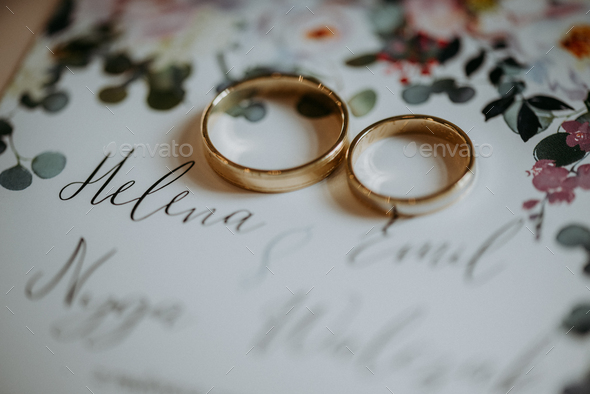 Wedding rings on invitation - Stock Photo - Images