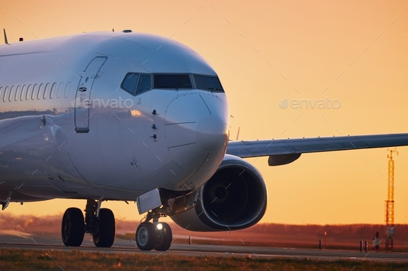 Airplane on airport runway - Stock Photo - Images