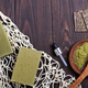Reusable shopping bags with handmade olive soap and green powder on dark wooden background. Zero - PhotoDune Item for Sale