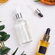 Beauty natural products with cosmetic cream, Omega-3 gel capsules, and serum in glass bottles on - PhotoDune Item for Sale