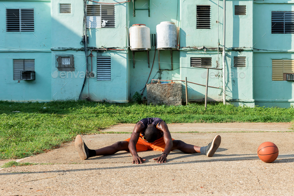 Young African American Man Doing Exercises On Outdoor Court in Cuba - Stock Photo - Images