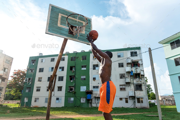 Young African American Man Playing Basketball On Outdoor Court in Cuba - Stock Photo - Images