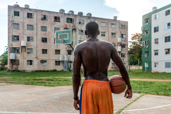 Back View Of Black Man Playing Basketball On Outdoor Court in Cuba - Stock Photo - Images