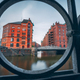 Speicherstadt warehouse district in Hamburg, Germany, Europe. Old brick buildings and channel of - PhotoDune Item for Sale