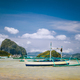 Traditional banca fishermen boat in shallow lagoon on Corong Beach. Nido, Philippines. Blue sky and - PhotoDune Item for Sale