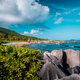 Picturesque tropical coastline with hidden beach with unique big granite rocks, lush foliage and - PhotoDune Item for Sale