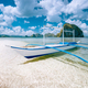 El Nido, Palawan, Philippines. Tropical scenery of banca boat on the sandy beach ready for island - PhotoDune Item for Sale
