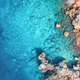 Aerial view of rocky beach and sea with transparent blue water - PhotoDune Item for Sale