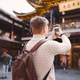 male tourist taking photos of a pagoda at Yuyuan market in Shanghai - PhotoDune Item for Sale