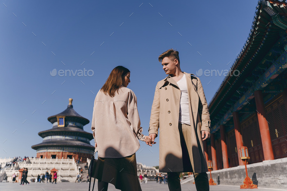 beautiful couple very much in love exploring China on their honeymoon - Stock Photo - Images