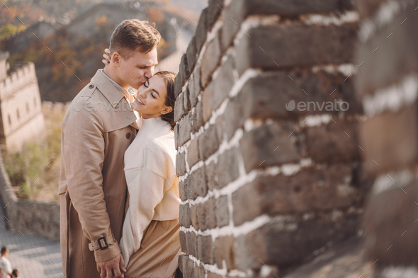 beautiful young couple hugging at the Great Wall of China - Stock Photo - Images