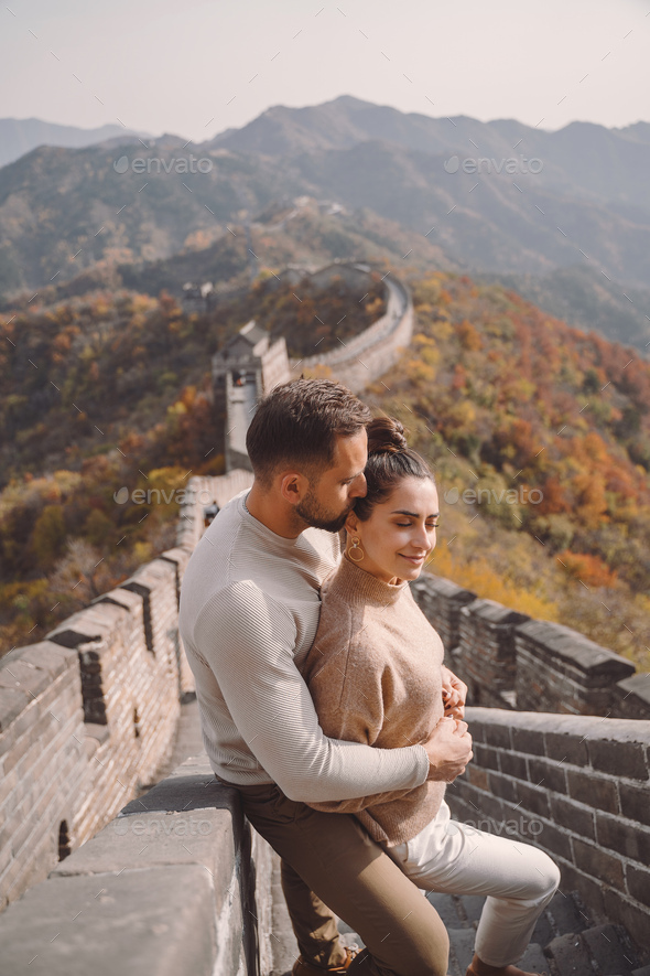 beautiful young couple showing affection on the Great Wall of China - Stock Photo - Images