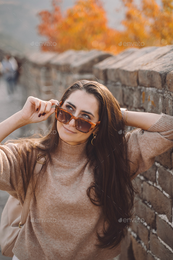 stylish girl wearing sunglasses visiting the Great Wall of China - Stock Photo - Images