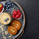 Flat lay view at vintage tray with ripe organic bilberry raspberry strawberry oat cookies - PhotoDune Item for Sale