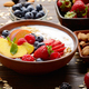 Fruit healthy muesli with peaches strawberry almonds and blackberry in clay dish - PhotoDune Item for Sale