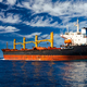 Cargo ship at sea against the blue sky. Logistics and cargo transportation - PhotoDune Item for Sale