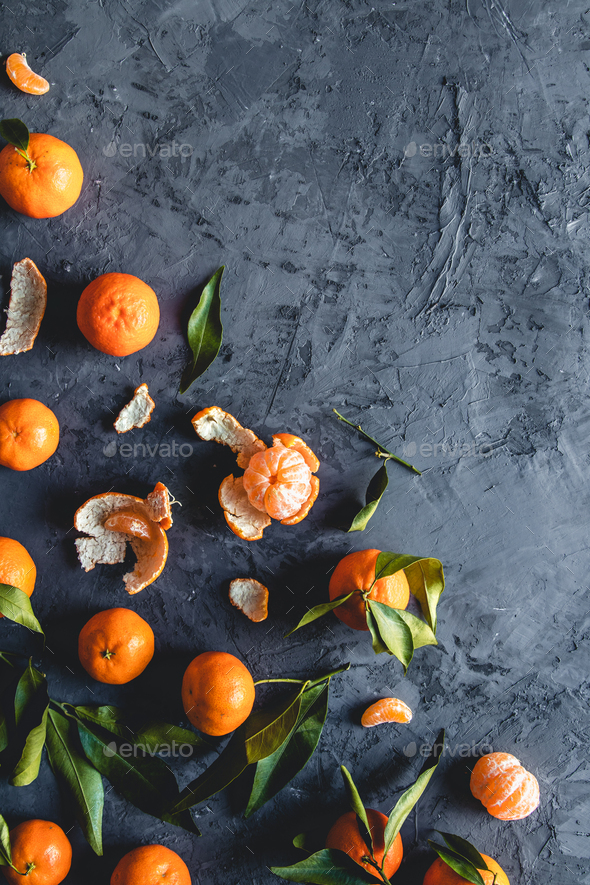 Juicy ripe tangerines with leaves on wooden table - Stock Photo - Images