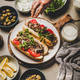 Mans hand over Turkish traditional meat sandwich tantuni - PhotoDune Item for Sale