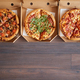 Three different kind of pizzas in delivery boxes - PhotoDune Item for Sale