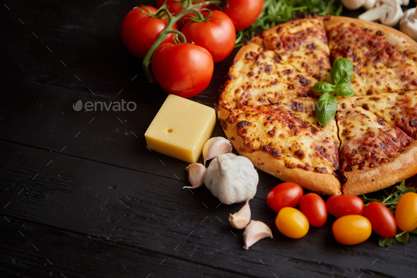 Fresh baked, hot american style pizza with all various ingredients on side - Stock Photo - Images