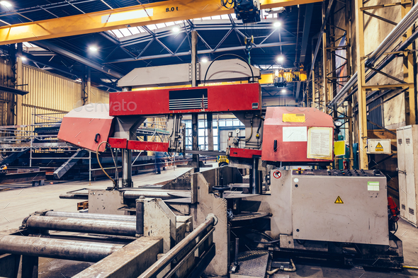 Saw machine for cutting steel profiles in a factory, - Stock Photo - Images