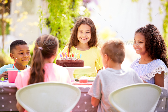 Girl Celebrating Birthday With Friends Having Party In Garden At Home - Stock Photo - Images