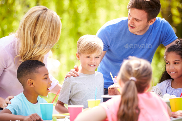 Parents And Son Celebrating Birthday With Friends Having Party In Garden At Home - Stock Photo - Images