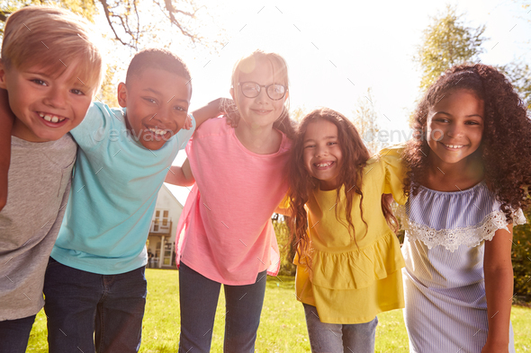 Portrait Of Smiling Children Outdoors At Home Looking Into Camera - Stock Photo - Images