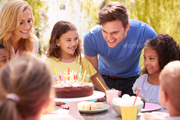 Parents And Daughter Celebrating Birthday With Friends Having Party In Garden At Home - Stock Photo - Images