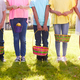 Close Up Of Five Children Holding Baskets On Easter Egg Hunt In Garden - PhotoDune Item for Sale