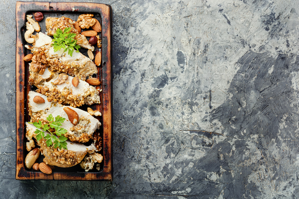 Roast chicken breast stuffed with walnuts and almond - Stock Photo - Images