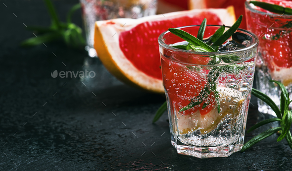 Alcoholic cocktail with grapefruit, soda, ice - Stock Photo - Images