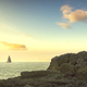 Sailboat on the sea and rocks in Castiglioncello at sunset. Rosignano, Tuscany, Italy - PhotoDune Item for Sale