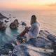 Beautiful tourist women enjoying sunset at Praia da Ursa Beach. Surreal scenery of Sintra, Portugal - PhotoDune Item for Sale