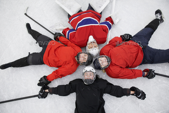 All Female Hockey Team Lying on Ice - Stock Photo - Images