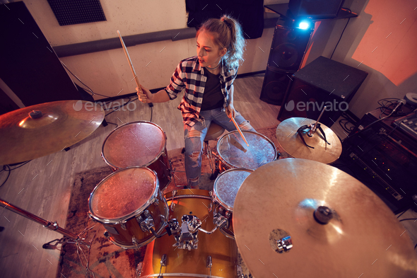 Young Woman Rocking Drums - Stock Photo - Images