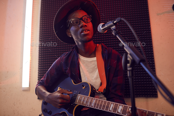 Young African Man Singing in Studio - Stock Photo - Images