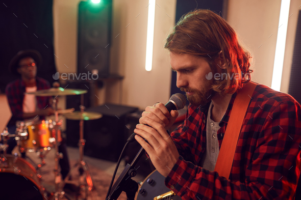 Handsome Young Man Singing in Studio - Stock Photo - Images